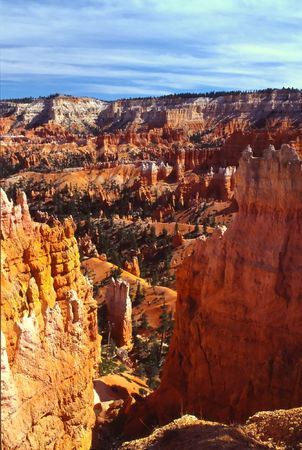 despite: Bryce Canyon National Park is a national park located in southwestern Utah in the United States. Contained within the park is Bryce Canyon. Despite its name, this is not actually a canyon, but rather a giant natural amphitheater created by erosion along t Stock Photo