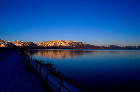 Lake Tahoe is a large freshwater lake in the Sierra Nevada mountains of the United States.  Stock Photo