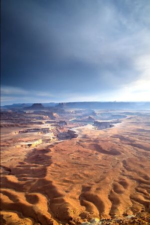 Canyonlands National Park is located in the American state of Utah, near city of Moab and preserves a colorful landscape eroded into countless canyons, mesas and buttes by the Colorado River and its tributaries. The rivers divide the park into four distri photo