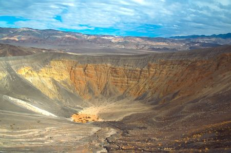 Ubehebe Crater is a large volcanic crater located at the north tip of the Cottonwood Mountains photo