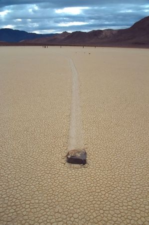Racetrack Playa is a seasonally dry lake (a playa) located in the northern part of the Panamint Mountains in Death Valley National Park, California, U.S.A.. It is famous for sailing stones, rocks that mysteriously move across its surface. photo