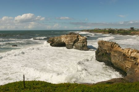 well known: Natural Bridges State Beach is a protected area in Santa Cruz, California, featuring a natural bridge across a section of the beach. It is also well known as a hotspot to see monarch butterfly migrations.