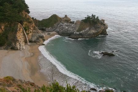 steinbeck: Big Sur is a sparsely populated region of the central California, United States coast where the Santa Lucia Mountains rise abruptly from the Pacific Ocean.