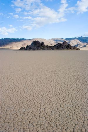 seasonally: Racetrack Playa is a seasonally dry lake (a playa) located in the northern part of the Panamint Mountains in Death Valley National Park, California.