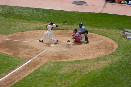 Baseball is a bat-and-ball sport played between two teams of nine players each. Stock Photo