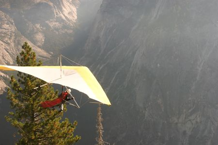 Hang gliding is an air sport in which a pilot flies a light and unmotorized foot-launchable aircraft called a hang glider. Stock Photo - 3173838