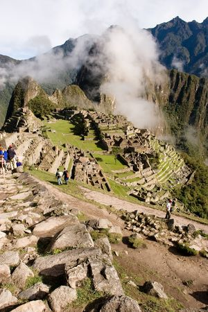 referred: Machu Picchu  is a pre-Columbian Inca site located 2,400 meters (7,875 ft) above sea level. It is situated on a mountain ridge above the Urubamba Valley in Peru, which is 80 km (50 mi) northwest of Cusco. Often referred to as The Lost City of the Incas,