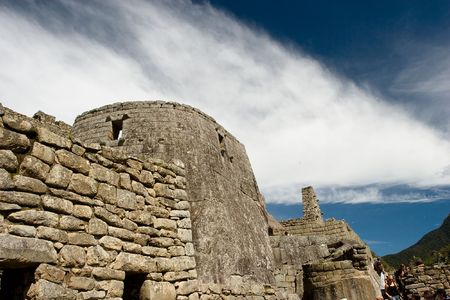 urubamba valley: Machu Picchu  is a pre-Columbian Inca site located 2,400 meters (7,875 ft) above sea level. It is situated on a mountain ridge above the Urubamba Valley in Peru, which is 80 km (50 mi) northwest of Cusco. Often referred to as The Lost City of the Incas,