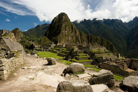 Machu Picchu  is a pre-Columbian Inca site located 2,400 meters (7,875 ft) above sea level. It is situated on a mountain ridge above the Urubamba Valley in Peru, which is 80 km (50 mi) northwest of Cusco. Often referred to as The Lost City of the Incas, photo