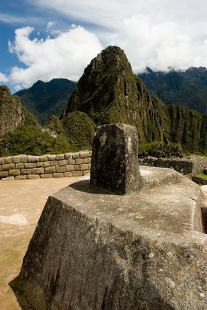 2 50: Machu Picchu  is a pre-Columbian Inca site located 2,400 meters (7,875 ft) above sea level. It is situated on a mountain ridge above the Urubamba Valley in Peru, which is 80 km (50 mi) northwest of Cusco. Often referred to as The Lost City of the Incas,