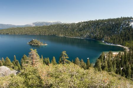 Lake Tahoe is a large freshwater lake in the Sierra Nevada mountains of the United States. It is located along the border between California and Nevada Фото со стока