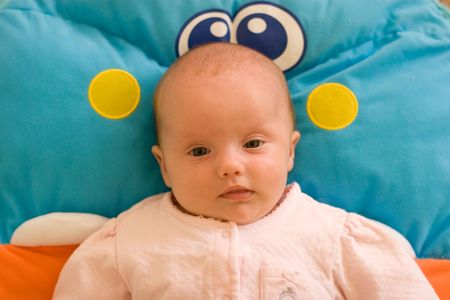 playmat: 2 month old baby girl on the playmat.
