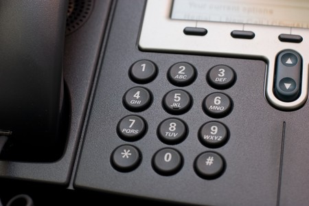 handset: Modern office phone using VoIP technology. Stock Photo