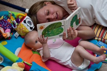Mother reading a book to little caucasian girl. Stock Photo - 4191225