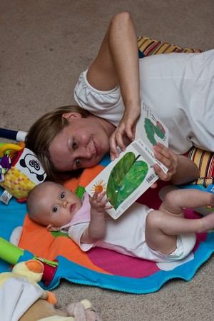 Mother reading a book to little caucasian girl. Stock Photo - 4208111