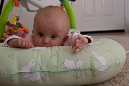 Caucasian baby girl playing on her colorful playmat. Stock Photo - 4316834