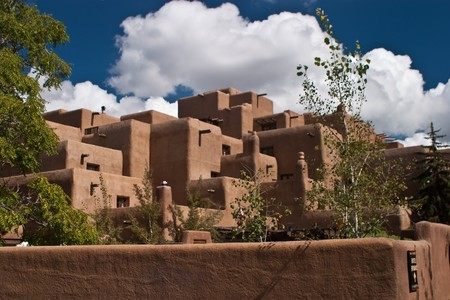 adobe pueblo: Santa Fe (Navajo: Yoo) is the capital of the state of New Mexico. It is the fourth-largest city in the state and is the seat of Santa Fe County. Stock Photo
