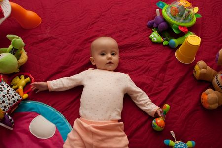 Little Caucasian baby girl playing on a floor. Imagens