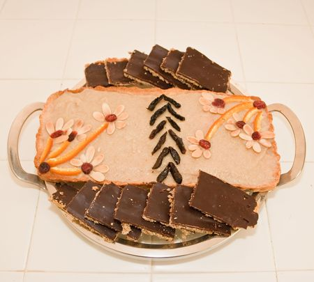 Polish Easter Cake. A softer version of shortbread, topped with almonds and cut into serving-sized squares. There is a variety of traditional toppings. Mazurek is usually colourfully iced and decorated with jam, nuts and raisins. photo