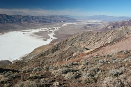 hottest: Dantes View is a viewpoint terrace at 5,475 feet (1.669 meters) height, on the North side of Coffin Peak, along the crest of the Black Mountains. Stock Photo