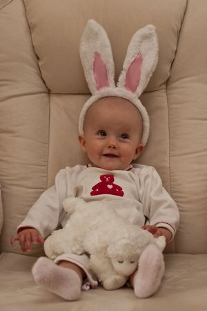 Little caucasian baby girl with Easter Bunny ears.