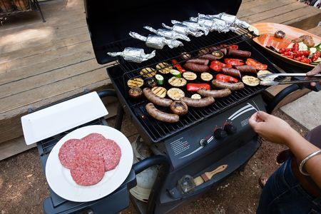 involves: Grilling is a form of cooking that involves dry radiant heat from above or below, and takes place on a grill or griddle Stock Photo