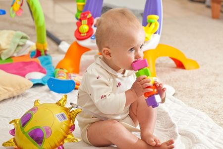 Caucasian baby girl playing on a floor. Stock Photo - 5187868