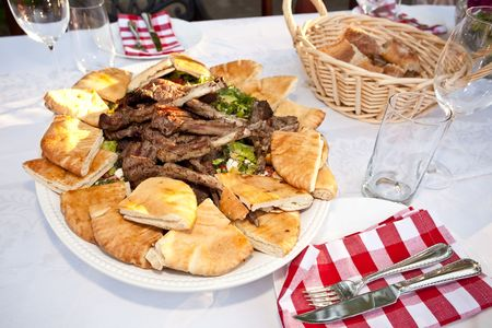 Grilled lamb ribs with pita bread and vegetables. photo