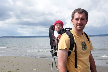 A child carrier or baby carrier is a device used to carry an infant or small child on the body of an adult. photo