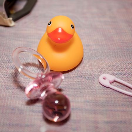 duckie: A rubber duck, rubber duckie, or rubber ducky, is a toy shaped like a duck, and is generally yellow.
