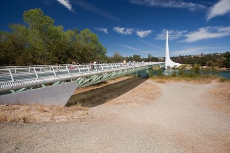 spar: Sundial Bridge is a cantilever spar cable-stayed bridge for bicycles and pedestrians that spans the Sacramento River in Redding, California Stock Photo