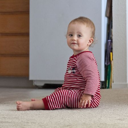 Cute Caucasian baby girl playing on a floor. photo