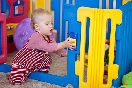 Cute Caucasian baby girl playing on a floor. Stock Photo - 5826719