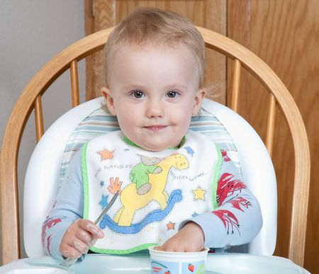 High chair is a piece of furniture used for feeding older babies and younger toddlers. Stock Photo - 5917530