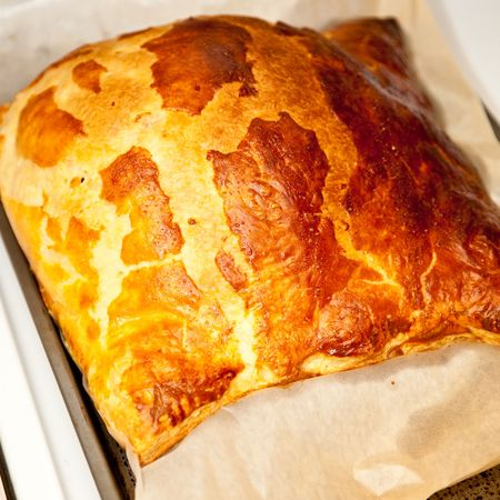 Puff pastry is a light, flaky, unleavened pastry containing several layers of fat photo