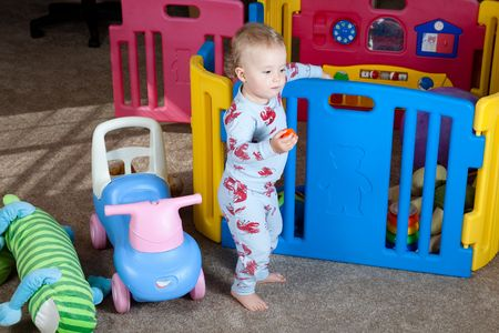 Cute Caucasian baby girl playing on a floor. Stock Photo - 6088212