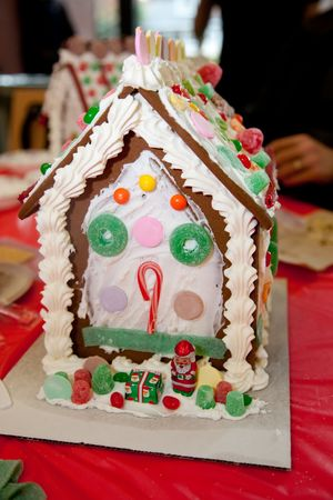 Gingerbread dough is used to build gingerbread houses similar to the witchs house encountered by Hansel and Gretel. These houses, covered with a variety of candies and icing, are popular Christmas decorations, typically built by children with the help  photo