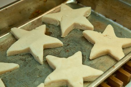 Shortbread is a type of biscuit (cookie) which is traditionally made from one part white sugar, two parts butter, and three parts oatmeal flour. The use of plain white (wheat) flour is common today, and other ingredients like ground rice or cornflour are Stock Photo - 6088214