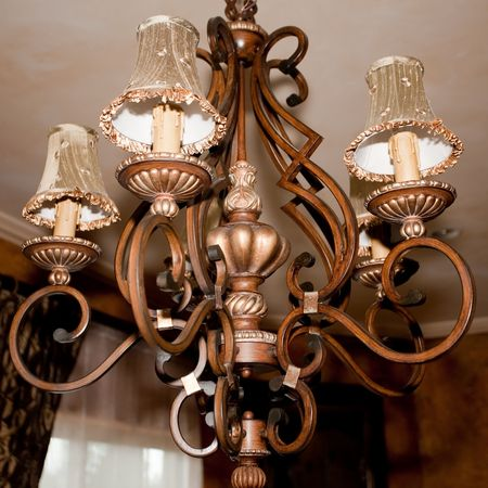 Chandelier is a branched decorative ceiling-mounted light fixture with two or more arms bearing lights. Stock Photo - 6149143