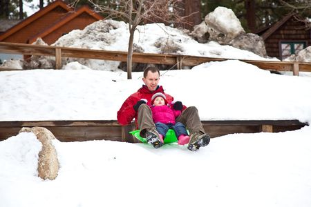 Sled refers to a smaller vehicle  and often one that is pulled by a human or propelled only by gravity. Stock Photo