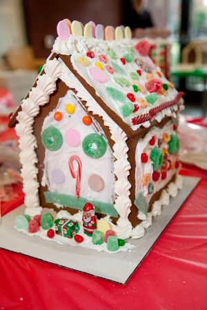 encountered: Gingerbread dough is used to build gingerbread houses similar to the witchs house encountered by Hansel and Gretel. These houses, covered with a variety of candies and icing, are popular Christmas decorations, typically built by children with the help