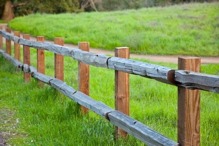 A fence is a freestanding structure designed to restrict or prevent movement across a boundary. Stock Photo - 6735794