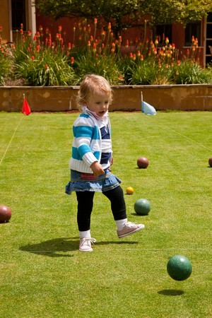 boules: Bocce  is a ball sport belonging to the boules sport family, closely related to bowls and p�tanque  with a common ancestry from ancient games played in the Roman Empire. Stock Photo