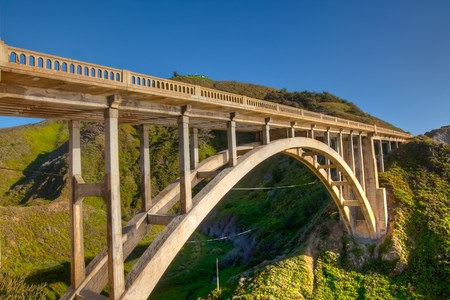 Rocky Creek Bridge is a reinforced concrete open-spandrel  arch bridge in California, built in 1932. Stock Photo