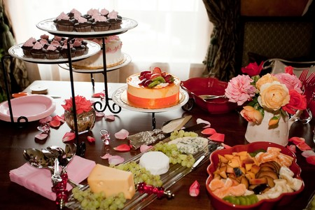 Beautifully decorated party setting with gourmet desserts and appetizers.