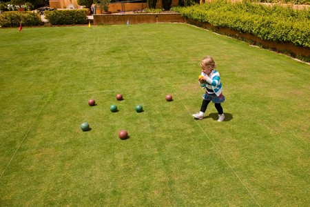 Boccie  is a ball sport belonging to the boules sport family, closely related to bowls with a common ancestry from ancient games played in the Roman Empire. photo