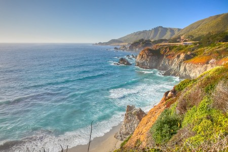 Big Sur is a sparsely populated region of the central California  coast where the Santa Lucia Mountains rise abruptly from the Pacific Ocean. Stock Photo - 7801748
