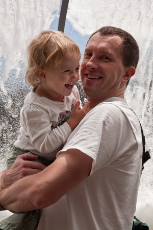 aquarium visit: Father holding his daughter in during a visit in aquarium.