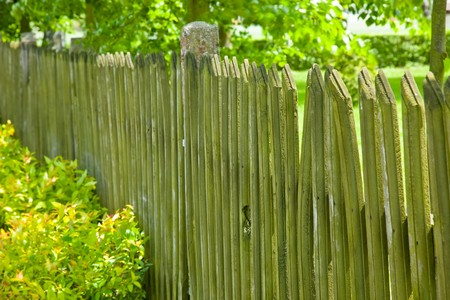 A fence is a freestanding structure designed to restrict or prevent movement across a boundary. Stock Photo - 7944479