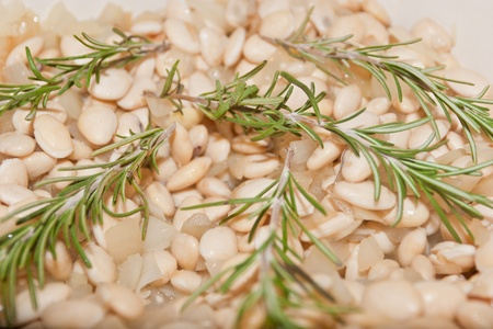 satisfying: Rosemary white bean soup is rich, healthy and satisfying, with woody flavor of the rosemary and the wholesomeness of the slightly al dente beans. Stock Photo